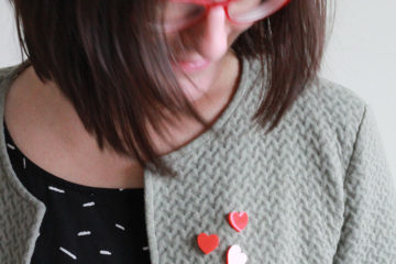 a subtle heart brooch to finish a look by Pop-a-porter