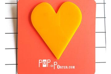 yellow oversized heart brooch by Pop-a-porter